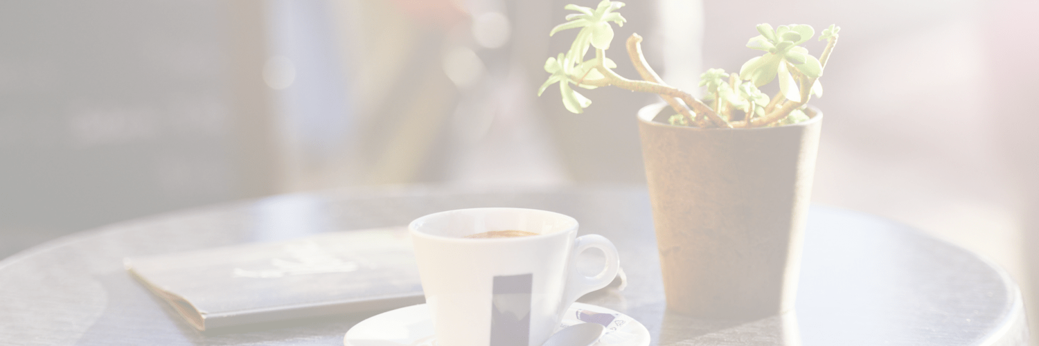 Coffee cup and plant